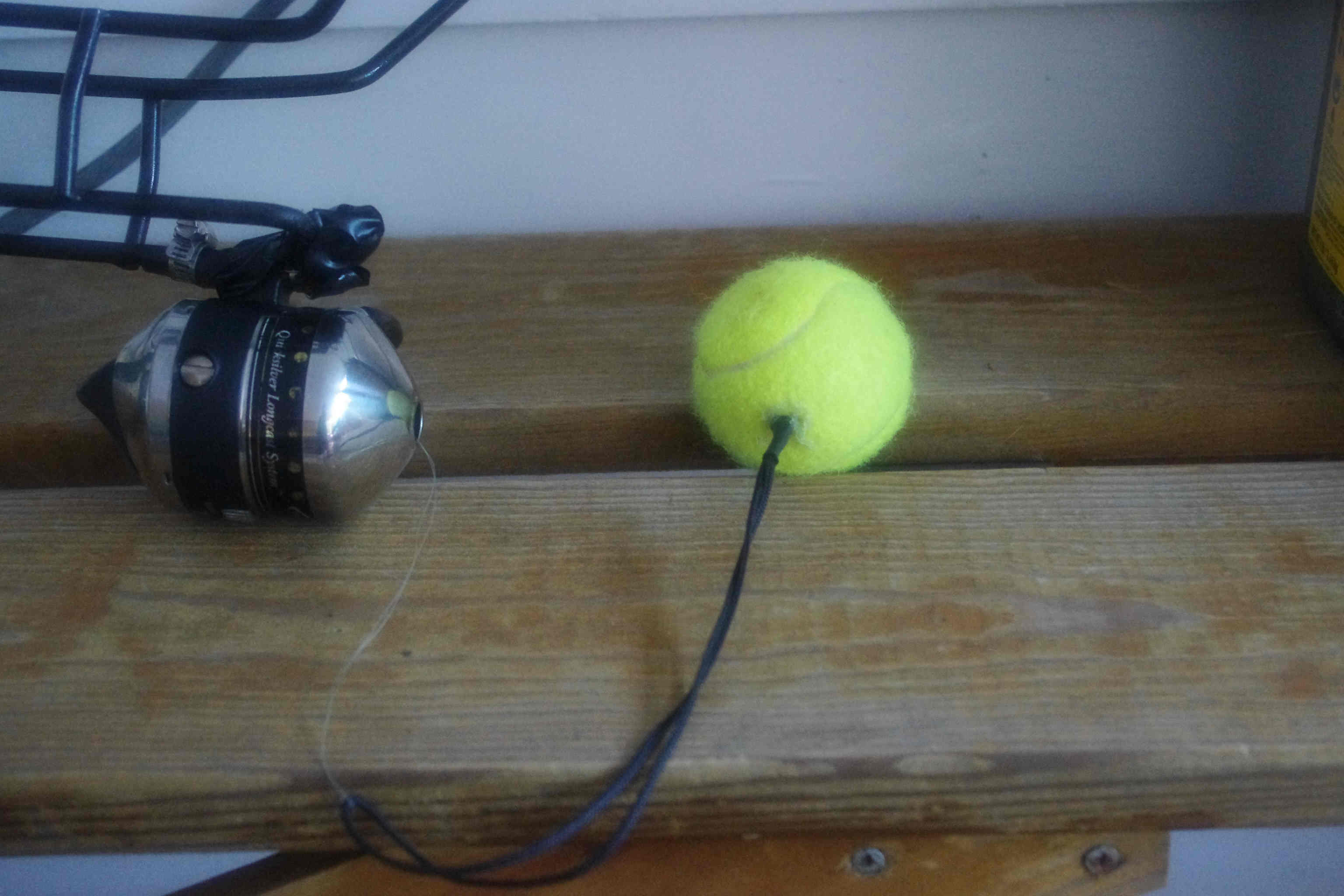 Photo of tennis ball modified for use as line launcher